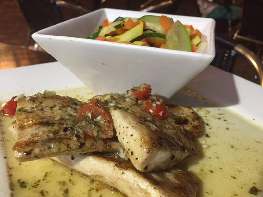 Seared mahi is served with a grape tomato and white wine sage sauce.
