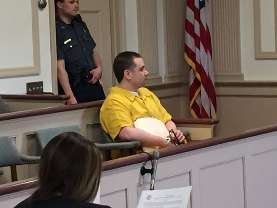 In yellow, Randy Fernandez prepares to plead guilty