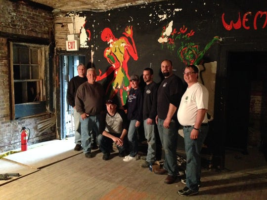 Volunteers from the Asbury Park Music Foundation remove artwork from the former Upstage Club in Asbury Park.