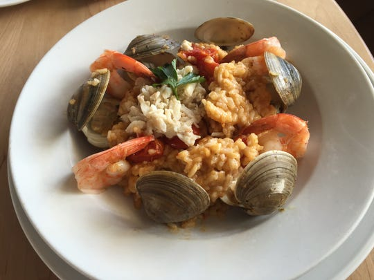 Spicy seafood risotto, with shrimp, clams and crab,