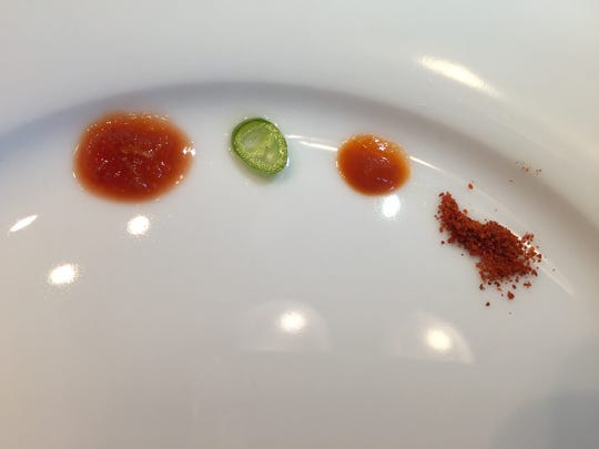 Basil makes its hot sauces in house, including a Thai chili, sauce, pickled chili peppers, sriracha and a chili powder blend.