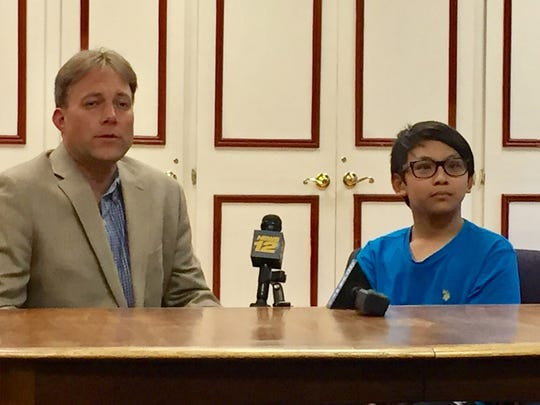 The Rev. Seth Kaper-Dale, pastor of The Reformed Church of Highland Park and Joel, 13, the son of Arino Massey, an ethnic Chinese Christian man, who was deported to Indonesia on Thursday.