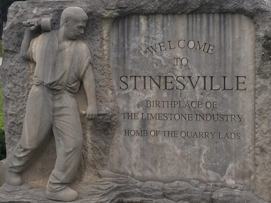 The sign welcoming folks to Stinesville pays homage to the past.
