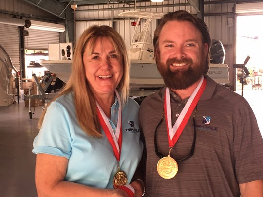 Diane Fricke, left, the owner of Fish Tale Boats, and her son Travis Fricke, the company's vice president of operations, received Governor's Business Ambassador medals from Gov. Rick Scott on Tuesday, May 30, 2017.