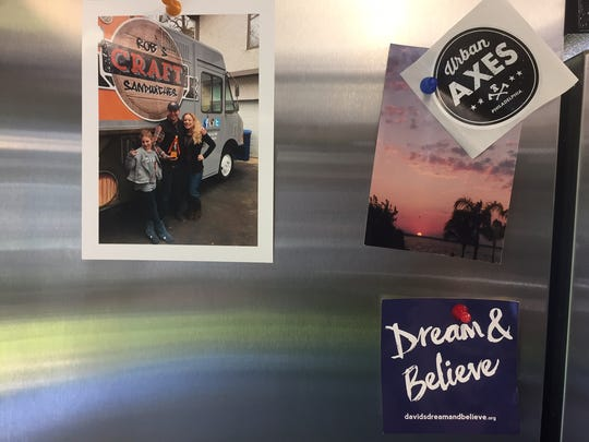 Jim and Kim Silcox and daughter Giana are shown in this snapshot with their new food truck. The family photo is proudly displayed inside the truck on the refrigerator.