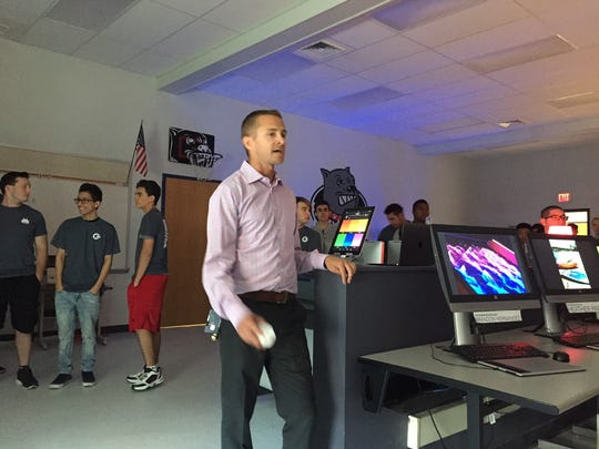 Old Bridge High School teacher Adrian Cline unveiled an arcade Wednesday that was designed and created by students in his Creative Design 3 class.