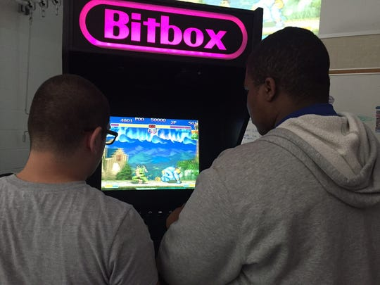 Students get a chance to try an arcade designed by students at Old Bridge High School.