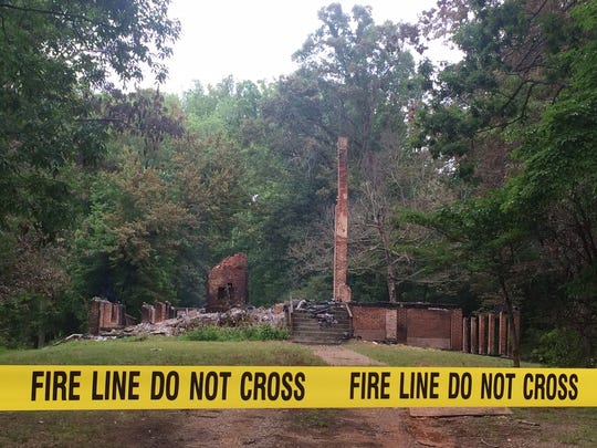 Only brick chimneys and foundation remained in the early morning hours of June 12, roughly 48 hours after the training began.