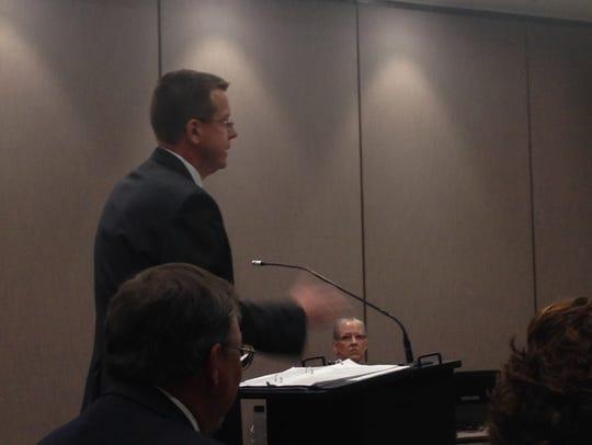 Teachers union attorney Eric Hylton addresses members