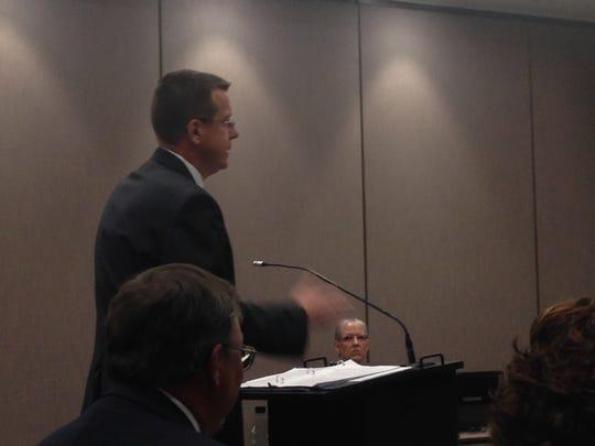 Teachers union attorney Eric Hylton addresses members of  IEERB.