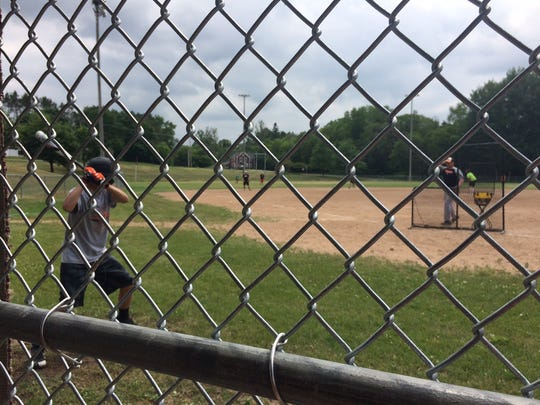 Iola-Scandinavia senior Nick Hansen takes some swings during practice Monday in preparation for a matchup with Laconia in a Division 3 state semifinal in Appleton.