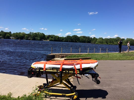 A stretcher is seen at a dock on Lake Wausau on Thursday, June 15, 2017 as emergency crews look for a boater who went missing near Memorial Park