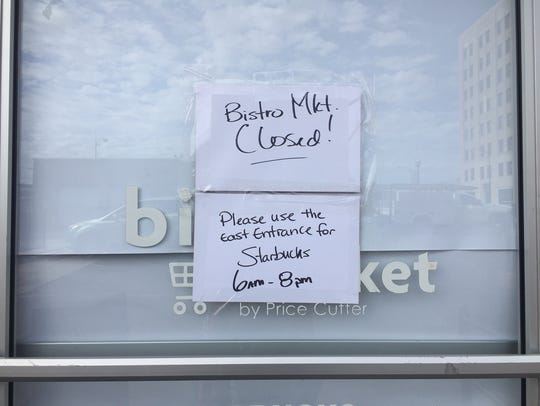 A sign posted Monday on a door to the Bistro Market.