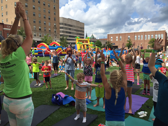 Children participate in yoga at Family Fitness Fest