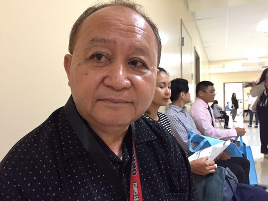 Kenneth Reyes, 62, a retiree who is returning to work