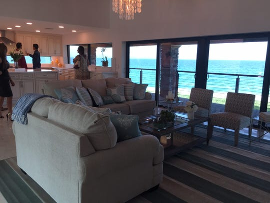 """Vanilla Ice, co-star Wes Kain and the """"Vanilla Ice Project"""" crew turned a dilapidated 7,000-square-foot home into a Polynesian-style retreat. Shown is the upstairs living room."""