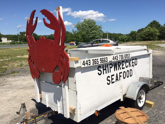 A sign for Shipwrecked Seafood at the corner of Main