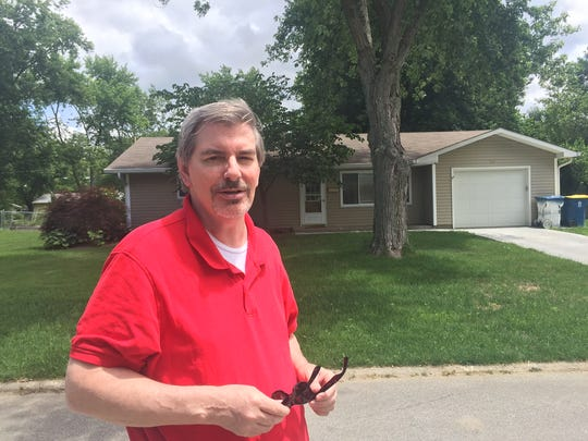 Mike Keen, Carmel High School Class of '68, in front of his childhood home.