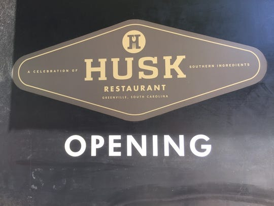 The sign that announces Husk Greenville's opening no