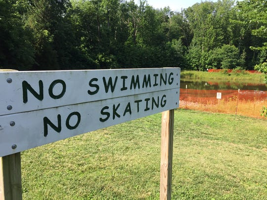 A fence has been installed around a pond in Talley Day Park after rumors alligators have taken up residence.