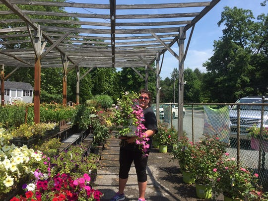 Customers made a final stop at Baker's Nursery in Monroe on Friday to bid farewell to owners and to purchase a few plants.