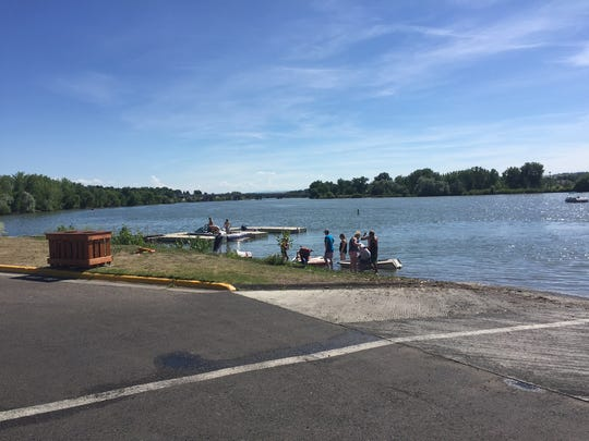 Jet skis and boats launch Saturday afternoon at Broadwater Bay in Great Falls.