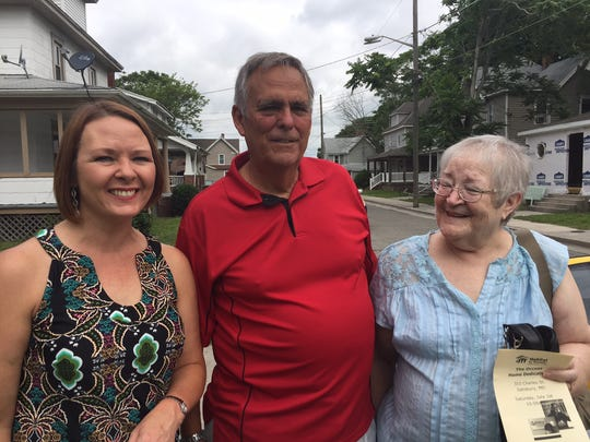 This Saturday, July 1, 2017 photo shows from left, Molly Hilligoss, executive director at Habitat for Humanity of Wicomico County, and Earl and Anita Herweck of Ocean Pines who donated a Charles Street house in Salisbury to Habitat. The house was dedicated on Saturday to new owners, Esau Occeas and his daughter, Veronica.