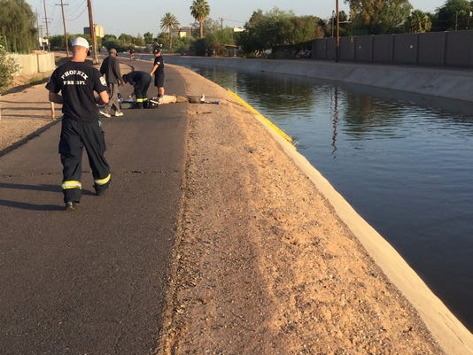 Phoenix Fire Department pulls man drowning from canal Monday morning.