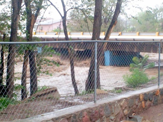 Cameron Creek rages with water during Sept. 20, 2013 at the bridge on Maple Street.