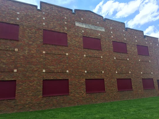 """The word """"GYMNASIUM"""" is still visible, etched in the concrete high above what was once of the quirkiest high school basketball gyms in Indiana, and is now a parking garage for Lincoln Park Apts in Greenfield."""