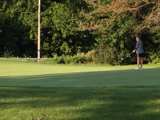 Kaylynn Adkins of Marion putts on No. 2 during the