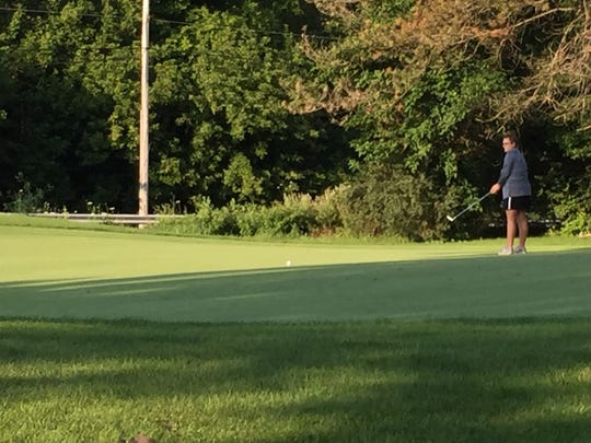 Kaylynn Adkins of Marion putts on No. 2 during the Ohio Junior Girls Championship at Marion Country Club Tuesday.