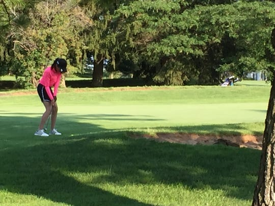 Dina Shaw takes a putt on the par-3 fifth hole at the Marion Country Club during the final round of the Ohio Junior Girls Championship on Tuesday. Shah was among the two youngest in the 76-player field and finished 60th overall.