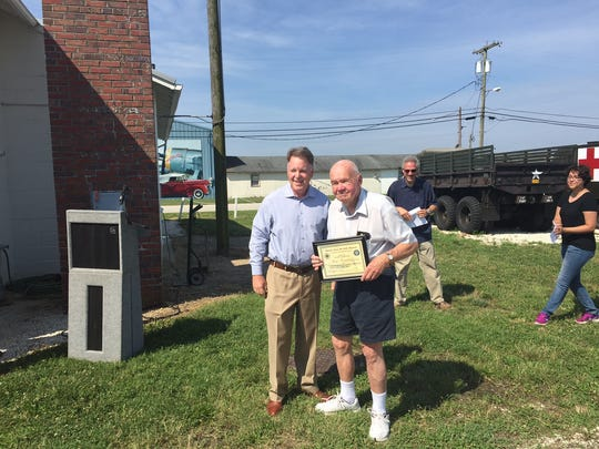 Millville Army Air Field Museum President Chuck Wyble (left) presented a certificate Wednesday to museum volunteer Ron Frantz. Frantz is in charge of keeping operational a Link flight simulator.