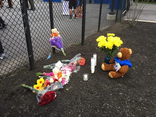 A memorial was set up at the entrance to the North Brunswick Township High School stadium in honor of Ibrahim Kargbo, who was struck and killed by a train on Friday.