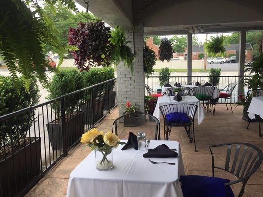 An inviting patio offers outdoor seating at Monsoon Fine Indian Cuisine in Cherry Hill.