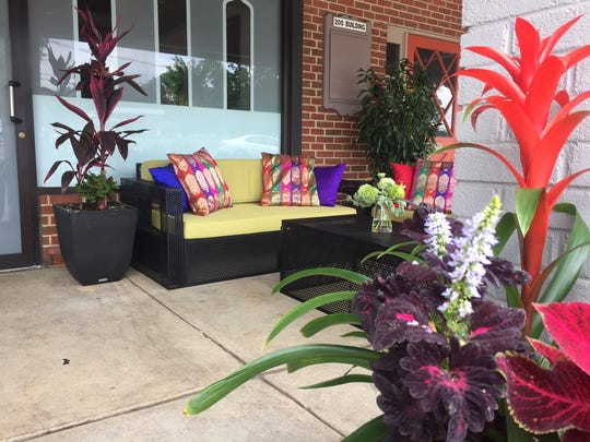 A colorful seating area greets guests at Monsoon Fine Indian Cuisine in Cherry Hill.