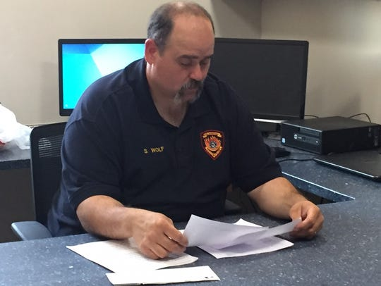 South River Fire Chief Scott Wolf goes over paperwork