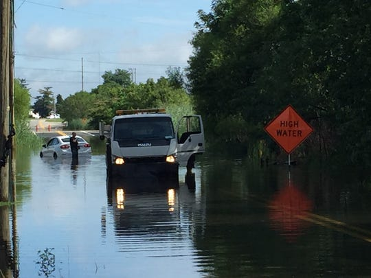 A car is stranded on Airport Road near  I-95 on Monday morning.