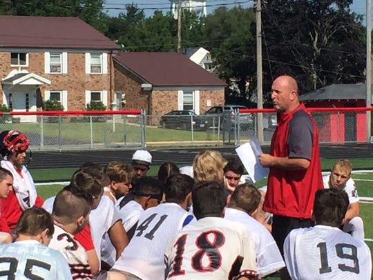 Harding football coach John Brady talks to his team