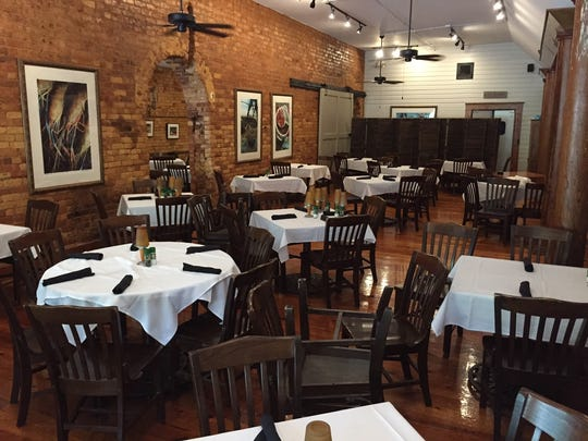 The dining room inside Sassafras Southern Bistro has new paint and new lighting, lending a brighter feel.