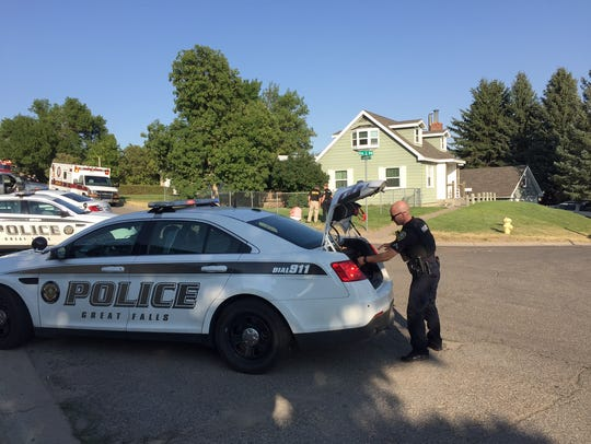 A Great Falls police officer prepares to leave the
