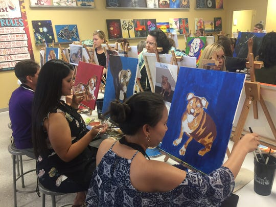 San Angelo artists work on portraits of their pets during Painting With A Twist's monthly charity event, Painting With A Purpose, which raised money for Cassie's Place Rescue.