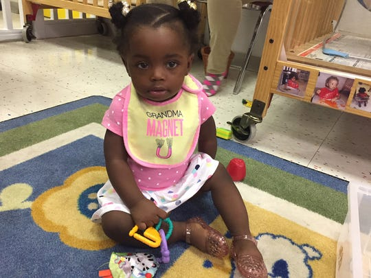 Logan, 10-months-old, at the Ministry of Caring's Child Care Center in Wilmington.