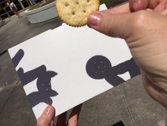 Using a Ritz cracker and a sheet of white paper, colleagues