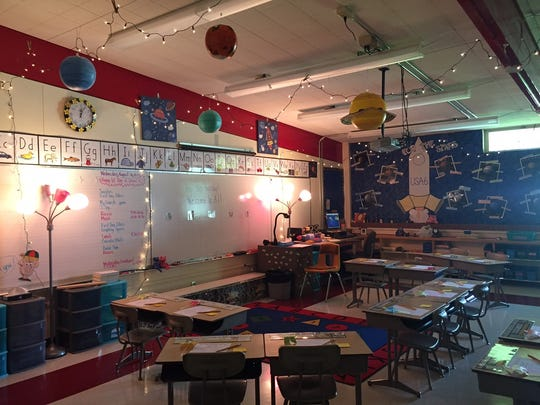 Elizabeth McWilliams' first-grade classroom has planets and star-like lights hanging from the ceiling.