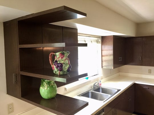 Cantilevered kitchen shelves remain strong after 65 years.