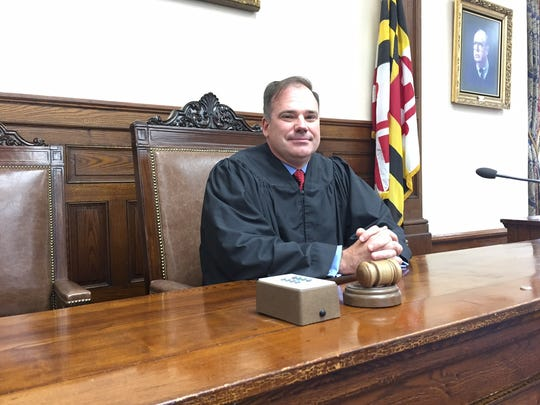 Somerset County Circuit Court Judge Daniel Powell, sworn in before a packed courtroom in the county seat of Princess Anne, tests the judge's seat wearing a robe belonging to his cousin, retired Somerset County District Court Judge R. Patrick Hayman. Powell was sworn in on Friday, Sept. 1.