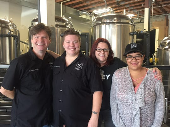 Geoff Bado, daughter Chelsea Goodermuth, wife Lisa White and daughter-in-law Samantha Masi gather in Zed's Beer tasting room in Marlton.