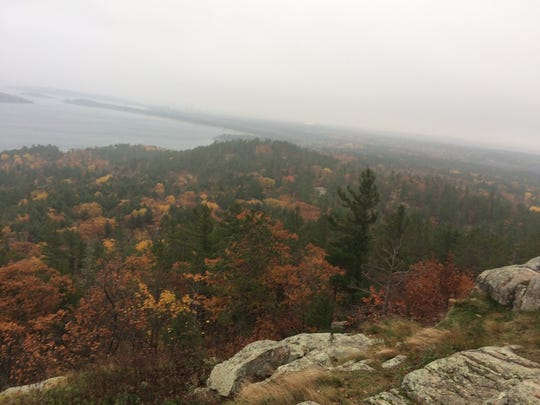The view of changing leaves from the top of a ledge on Sugarloaf Mountain in Marquette, Mich.